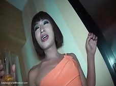 Pissing Ladyboy Gets Ready to Bareback Guy